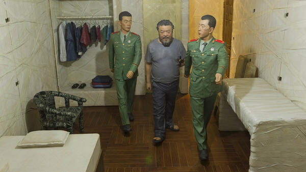 One of Ai Weiwei's dioramas shows guards leading him into his small cell where he spent 81 days in solitary confinement.