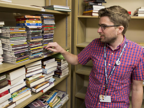Iowa City librarian Jason Paulios reviews recently donated CDs. Paulios says donations of old music give the library greater freedom to purchase new stuff, as well as license digital versions directly from smaller artists.
