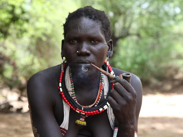 A gold miner in the eastern part of South Sudan takes a break. Miners say it used to be easy to find gold nuggets. But now tens of thousands of South Sudanese are mining, and it can take days to find a single gram.