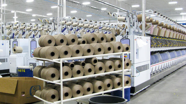 Large spools of fiber in the Engineered Floors carpet plant in Dalton, Ga.