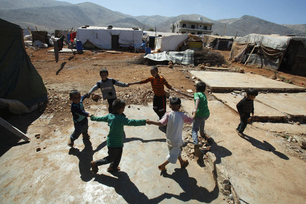 Children play at a refugee camp in Terbol, Lebanon in July 31. At a camp in Terbol, refugees beseech visiting aid workers to improve sanitation and other services at the site. Formerly a settlement for migrant workers on privately owned land, the site's unplanned growth in recent months has strained already limited resources.
