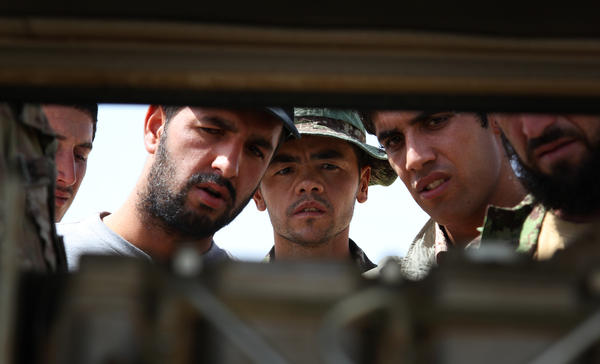 Afghan soldiers and contractors are taught about the workings of a diesel-powered electrical generator at Forward Operating Base Nolay in Helmand province.
