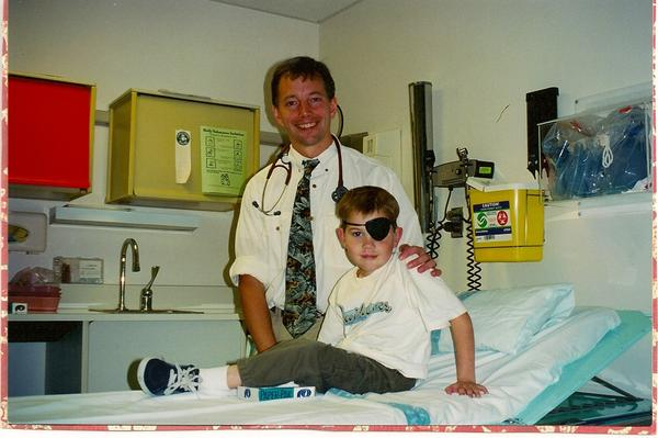 "Six-year-old Hayden Strum, in 1998, with Dr. Jim Olson. Hayden, who died of cancer, was a charmer who had a way of ""collecting hearts,"" his mother says."