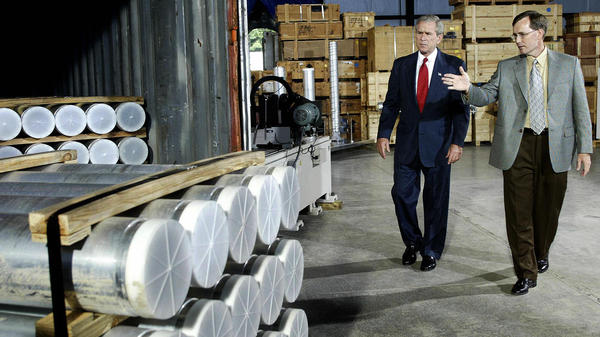 President George W. Bush receives a tour of nuclear material surrendered by Libya and flown to the Oak Ridge National Laboratory, a U.S. facility in Oak Ridge, Tenn., in 2004.