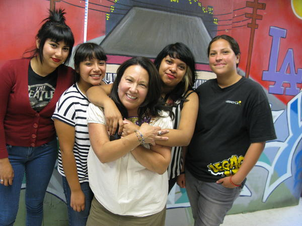 Evangeline Ordaz (center) stands with teens from Legacy LA who were her script consultants and extras for <em>East Los High.</em> From left: Rebecca Hernandez, Brenda Flores, Ordaz, Wesley Michua, Marlene Arazo.