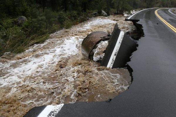 A section of Highway 72 is missing after a flash flood tore through Coal Creek near Golden, Colo., on Thursday.