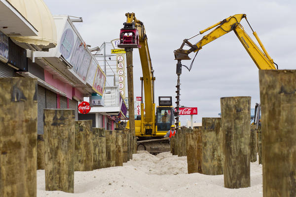 Construction workers put pilings into the sand as the reconstruction of the boardwalk continued in Seaside Heights in February. Sandy caused extensive damage to the boardwalk necessitating its demolition and rebuilding.