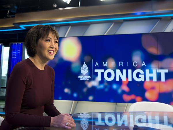 Joie Chen, host of the new Al Jazeera America nightly news program America Tonight, sits at the anchor desk in the network's studio space at the Newseum in Washington, D.C.