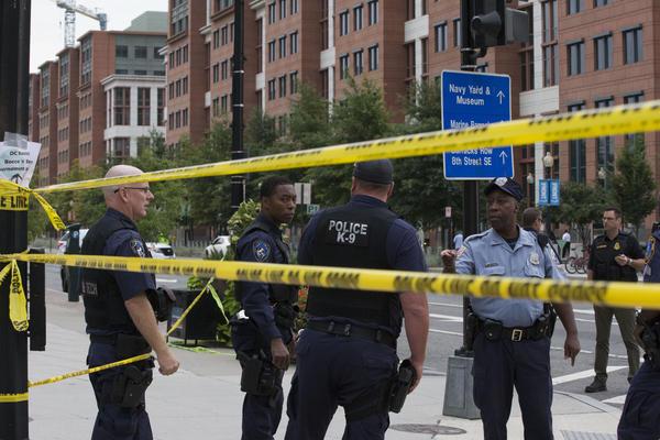 Police monitor the area near the Navy Yard.