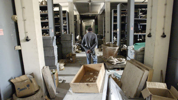 An Iraqi civilian walks through the vault of the National Museum in Baghdad, Iraq, on April 12, 2003. Looters opened the museum vault, went on a rampage breaking ancient artifacts stored there by museum authorities before the war started.