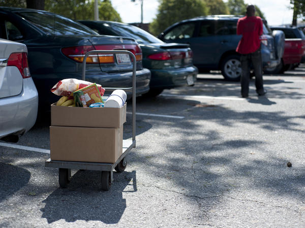 Food distributed by the Manna Food Center is packed in cardboard boxes to be loaded into clients' cars.