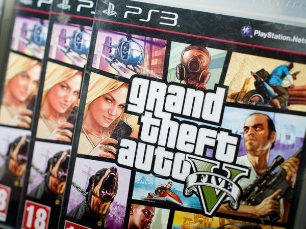 A close view of the packaging of Grand Theft Auto V at the midnight opening at the HMV music store in London on Tuesday. It made history with a record $800 million in sales on its first day. This version continues to generate controversy over its glorification of violence, drugs and its demeaning portraits of women.