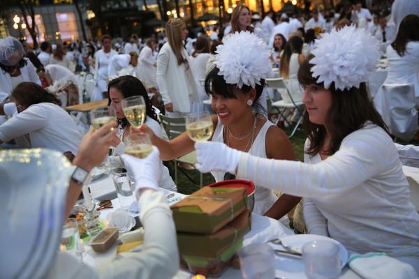 "At Diner en Blanc (""Dinner in White""), people arrive dressed all in white. They bring their own food and, fittingly,"" white wine."