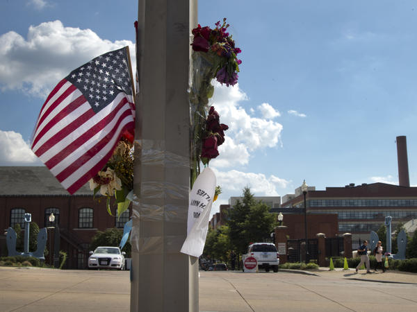 A makeshift memorial hangs on a lamp post across the street from the Washington Navy Yard, on Sept. 20.