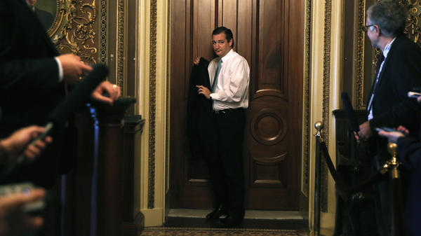 Texas Sen. Ted Cruz leaves the weekly Senate Republican Policy Committee luncheon Tuesday, shortly before beginning a filibuster against Obamacare.