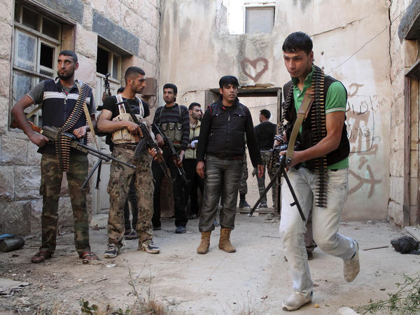 Free Syrian Army fighters prepare to raid a house in Dara'a on May 16.