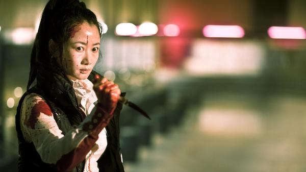 In one of the four intertwining storylines of the brutal Chinese drama <em>A Touch of Sin,</em> a young receptionist (Zhao Tao) must resort to violence to defend herself.
