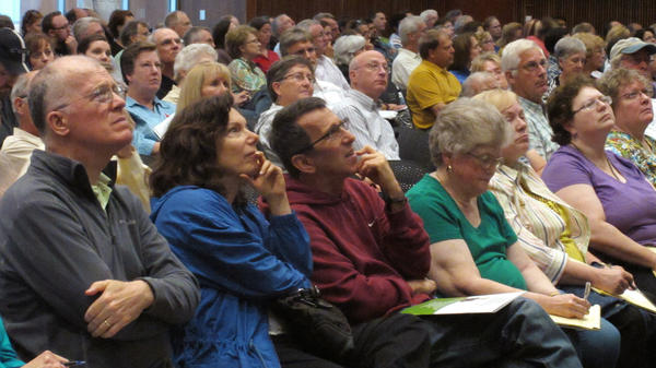 The audience concentrates on a presentation by Kansas Insurance Commissioner Sandy Praeger's office about the federal health care overhaul at the University of Kansas satellite campus in Overland Park, Kan., earlier this month.