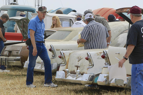 Car buffs look over Chevrolet vehicles during a preview Friday for an auction of vintage cars and trucks from the former Lambrecht Chevrolet dealership in Pierce, Nebraska.