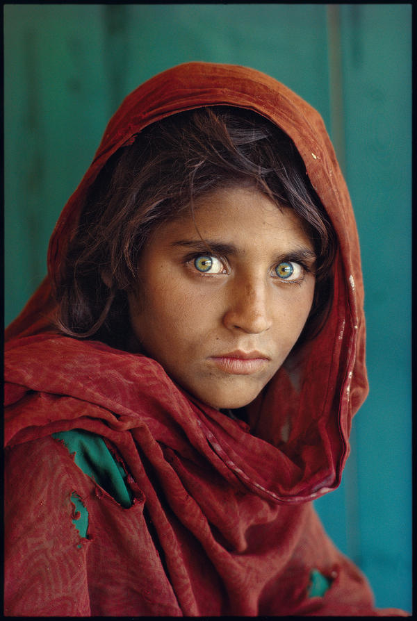 Steve McCurry's iconic photograph of a young Afghan girl in a Pakistani refugee camp appeared on the cover of <em>National Geographic</em> magazine's June 1985 issue and became the most famous cover image in the magazine's history.