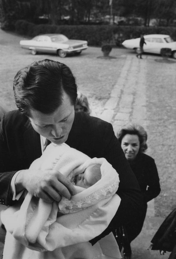 Sen. Edward Kennedy holds baby Rory Elizabeth Katherine Kennedy as Robert Kennedy's widow, Ethel, looks on, after Rory's January 1969 baptism in McLean, Va. Rory was the last of Ethel and Robert's 11 children.
