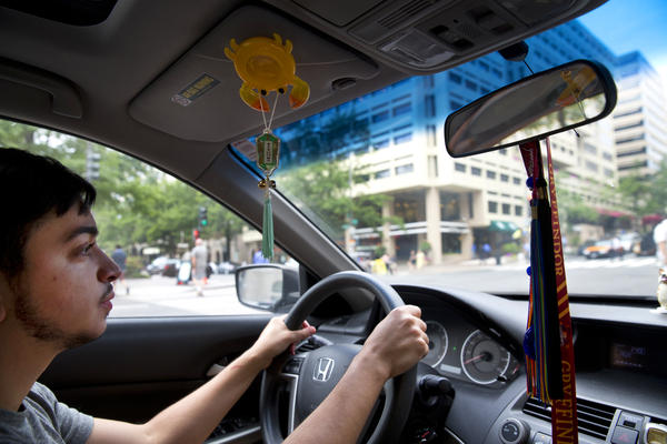 Younes drives in D.C. to meet his parents for lunch. Initially apprehensive about his transition, Younes' parents are now supportive of him as their son.