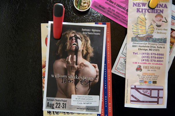 A flier for a production of <em>The Tempest</em> hangs on Younes' refrigerator. He will play the part of Alonso with the DNA Theatre in Baltimore. After his transition, theater became a big part of Younes' life, a way for him to express himself and socialize with other people.