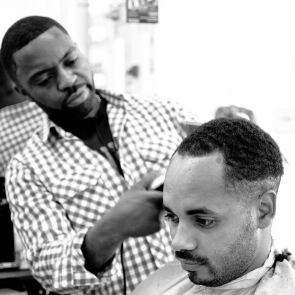 London barber Faisal Abdu'Allah cuts director Andy Mundy-Castle's hair.