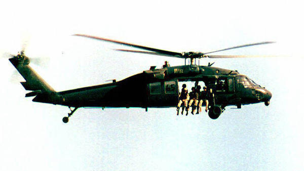 A U.S. UH-60 Black Hawk helicopter flies over Somalia in September 1993, a month before the battle of Mogadishu.