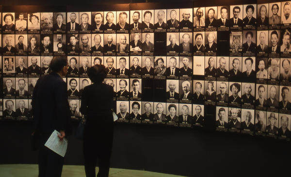 Visitors viewing photographs of deceased Minamata disease victims displayed at the Minamata Tokyo Exhibition in 1996 (Timothy S. George)
