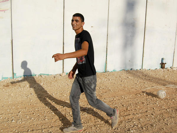 Ishaq, 19, still loves to play soccer with his family and friends.
