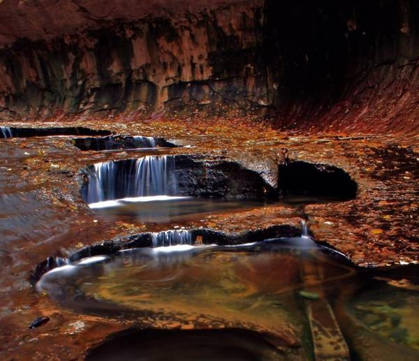 "An autumn scene in the canyon known as ""The Subway"" in Zion National Park in Utah, which is now off-limits to hikers and other tourists due to the government shutdown."