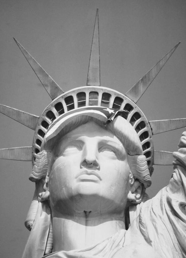 The Puerto Rican flag is draped across the crown of the Statue of Liberty on Oct. 25, 1977, after demonstrators occupied the monument.