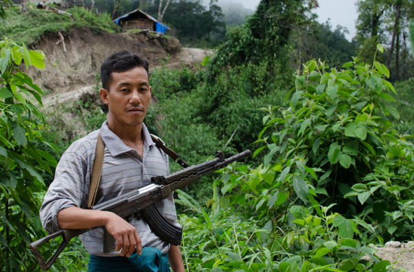 A KIA soldier patrols the hills of Kachin State. Earlier this year, a major military offensive by the Burmese army pressed the KIA forces up against the Chinese border.