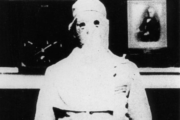 Inmates once were hooded so they would not be recognized by guards or other inmates, allowing for anonymity upon release. Eyeholes were allowed in hoods circa 1890, but prisoners were still not allowed to communicate.