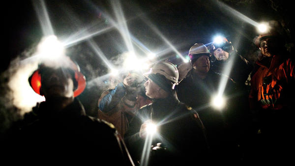Workers stand inside the gold mine in Greenland's Nulanaq mountain in 2009. The Danish territory's underground wealth was at the forefront of elections in March. Now, Greenland faces another dilemma: whether to end a zero-tolerance policy on uranium extraction.