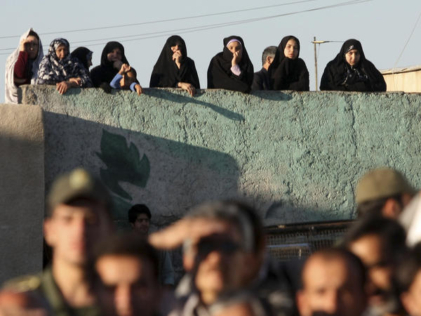 Iranians watch the hanging of a convicted man in the city of Qazvin, northwest of the capital, Tehran, in May 2011.