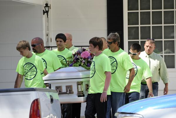 Pallbearers wearing anti-bullying t-shirts carry the casket of Rebecca Sedwick,12, to a waiting hearse as they exit the Whidden-McLean Funeral Home Monday, Sept. 16, 2013, in Bartow, Fla. (AP/Brian Blanco)