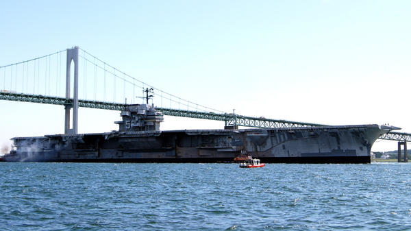 The decommissioned aircraft carrier USS Forrestal departs Newport, R.I., for a three-day cruise to Philadelphia in 2010.