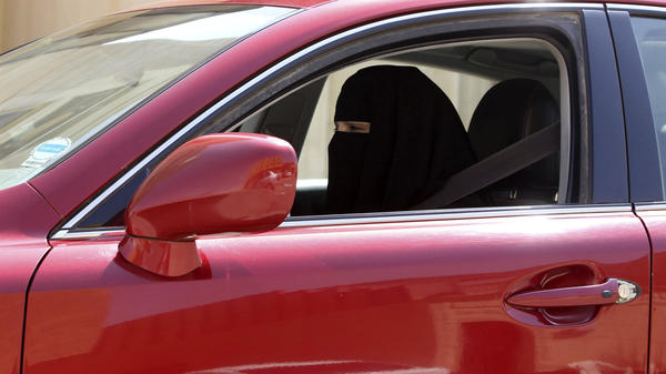 A woman drives a car in Saudi Arabia on Sunday. Saudi Arabia is the only country where women are barred from driving, but activists have launched a renewed protest and are urging women to drive on Saturday.