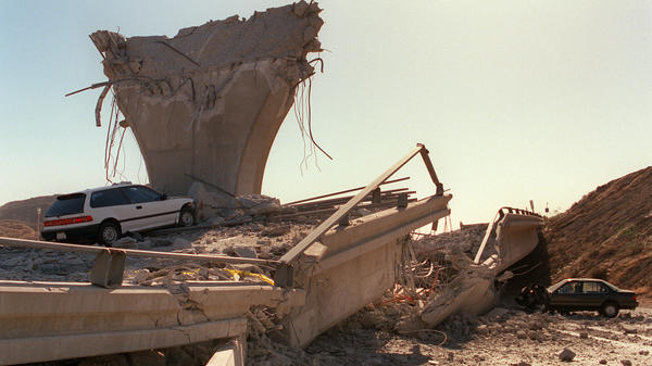 Cars lie smashed by the collapsed Interstate 5 connector a few hours after the Northridge earthquake on Jan. 17, 1994, in California.