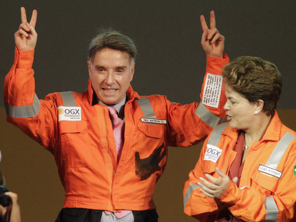 Batista appears with Brazilian President Dilma Rousseff during a ceremony in celebration of the start of oil production by OGX, Batista's oil and gas company, in 2012. The company filed for bankruptcy Wednesday.