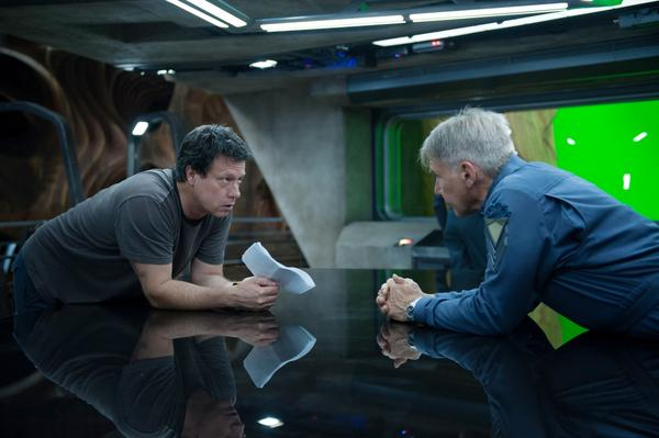 """Director and screenwriter Gavin Hood (left) talks with Harrison Ford, who plays Colonel Graff on the set of the new movie """"Ender's Game."""" (Richard Foreman Jr., SMPSP, © 2013 Summit Entertainment, LLC. All Rights Reserved.)"""