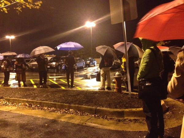 Slugs brave rainy conditions as they wait to be picked up by drivers looking to take advantage of high-occupancy vehicle lanes.