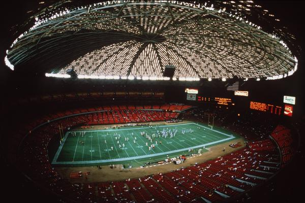 "An interior shot of the Houston Astrodome taken in 1990. The stadium was ""the first fully air-conditioned, enclosed, domed, multipurpose sports stadium in the world,"" according to the Texas Historical Association."
