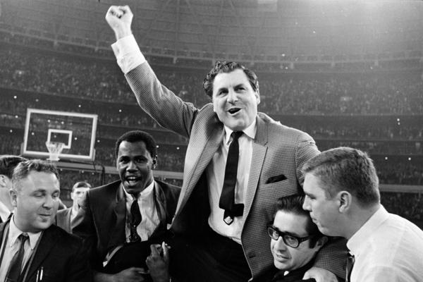 "Guy V. Lewis, University of Houston basketball coach, is carried to the dressing room by happy fans after the Cougars' upset win over UCLA in an NCAA college basketball game at the dome on Jan. 20, 1968. The game was known as college basketball's ""Game of the Century."""