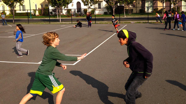 Students play tag at Ruby Bridges Elementary in Alameda, Calif. The school has expanded recess time with help from the nonprofit group Playworks.