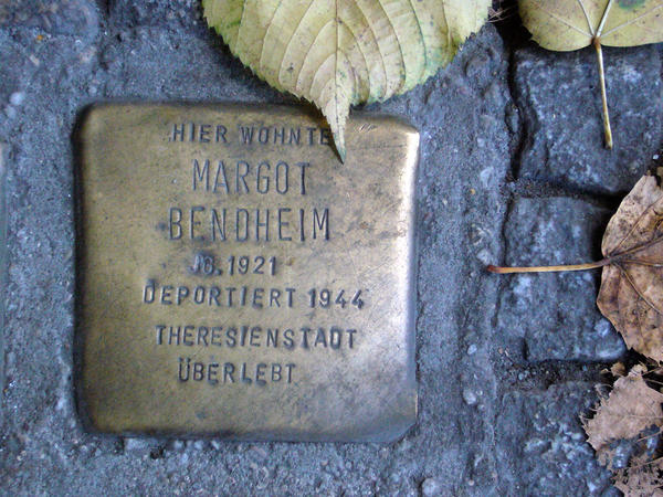Brass cobblestones in Berlin sidewalks mark the last known addresses of the city's Jewish residents before the war. Margot Friedlander, nee Bendheim, now lives at a different address in Berlin, where she returned to from New York three years ago.