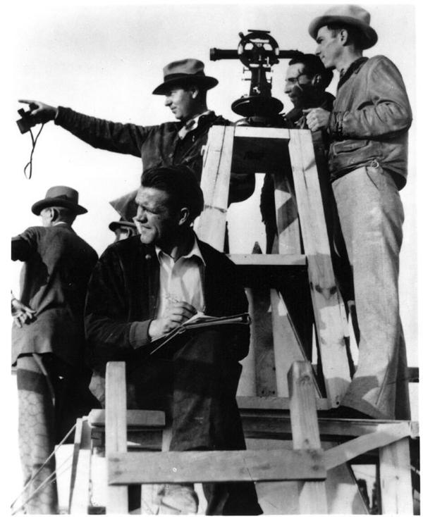 """A """"triangulation party"""" measures from the top of the Washington Monument on Nov. 19, 1934. Scaffolding was set up to clean the structure."""