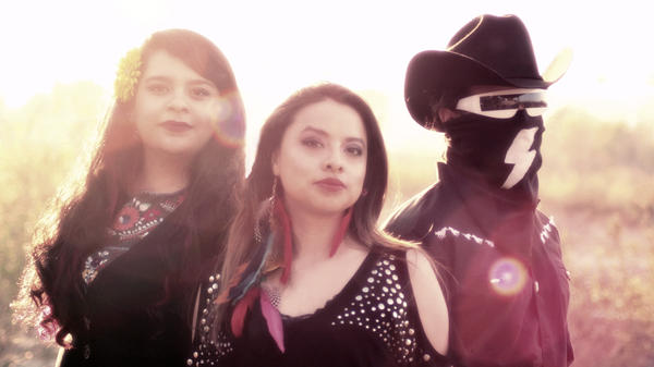 ¡Aparato! is a Los Angeles trio that fuses rock with sounds and instruments from Mexico's <em>son jarocho</em> tradition.